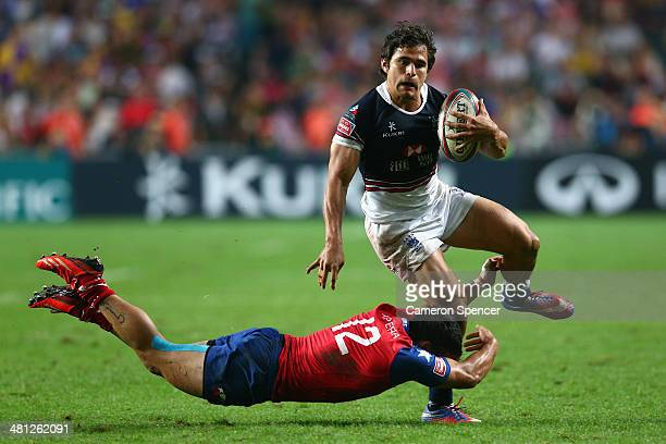 Alex McQueen of Hong Kong makes a break during the Qualifying Quarterfinal match between Chile and Hong Kong during the 2014 Hong Kong Sevens at Hong...