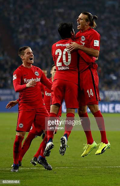 Alex Meier of Frankfurt celebrate with his team mates after scoring the opening goal during the Bundesliga match between FC Schalke 04 and Eintracht...