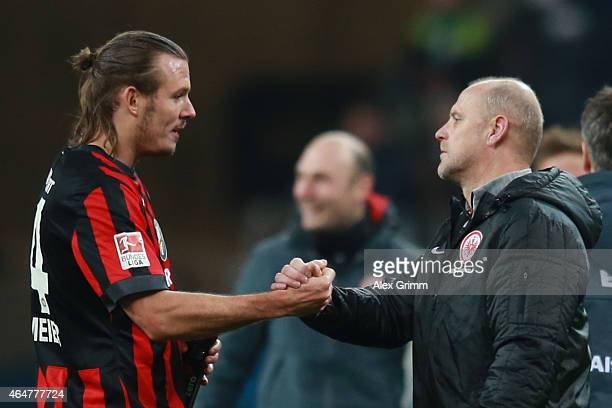 Alex Meier of Frankfurt celebrates victory with his head coach Thomas Schaaf after the Bundesliga match between Eintracht Frankfurt and Hamburger SV...
