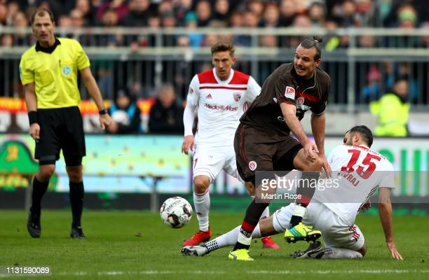 Alex Meier of St Pauli challenges Mergim Mavraj of Ingolstadt during the Second Bundesliga match between FC St Pauli and FC Ingolstadt 04 at...