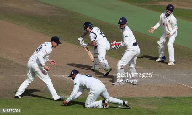 Alex Mellor of Warwickshire is caught in the slips by Varun Chopra during the Specsavers County Championship Division One match between Warwickshire...