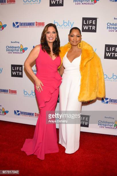 Alex Meneses and Garcelle Beauvais attend the Byron Allen's Oscar Gala Viewing Party to support the Children's Hospital Los Angeles at the Beverly...