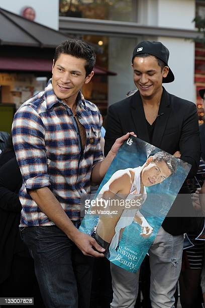 Alex Meraz and Bronson Pelletier of the Wolfpack visit Extra at The Grove on November 15 2011 in Los Angeles California