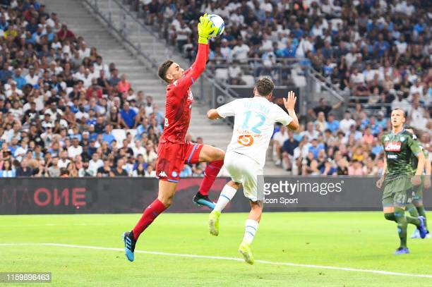 Alex Meret of Napoli and Kevin Strootman of Marseille during the Friendly match between Marseille and Napoli at Stade Velodrome on August 4 2019 in...
