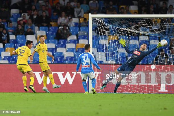Alex Meret of SSC Napoli saves on Matteo Pessina of Hellas Verona during the Serie A match between SSC Napoli and Hellas Verona at Stadio San Paolo...