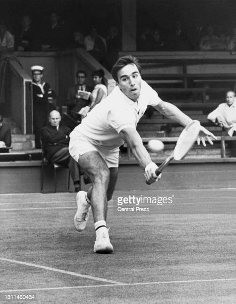 Alex Metreveli of the Soviet Union keeps his eyes on the tennis ball as he reaches to make a backhand return to Brian Fairlie of New Zealand during...
