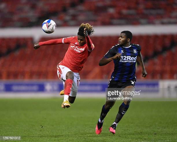 Alex Mighten of Nottingham Forest jumps to head the ball under pressure from Anfernee Dijksteel of Middlesbrough during the Sky Bet Championship...