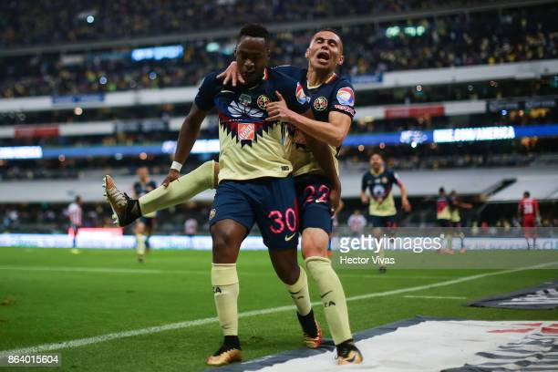Alex Mina of America celebrates with Paul Aguilar after scoring the second goal of his team during the 10th round match between America and Chivas as...