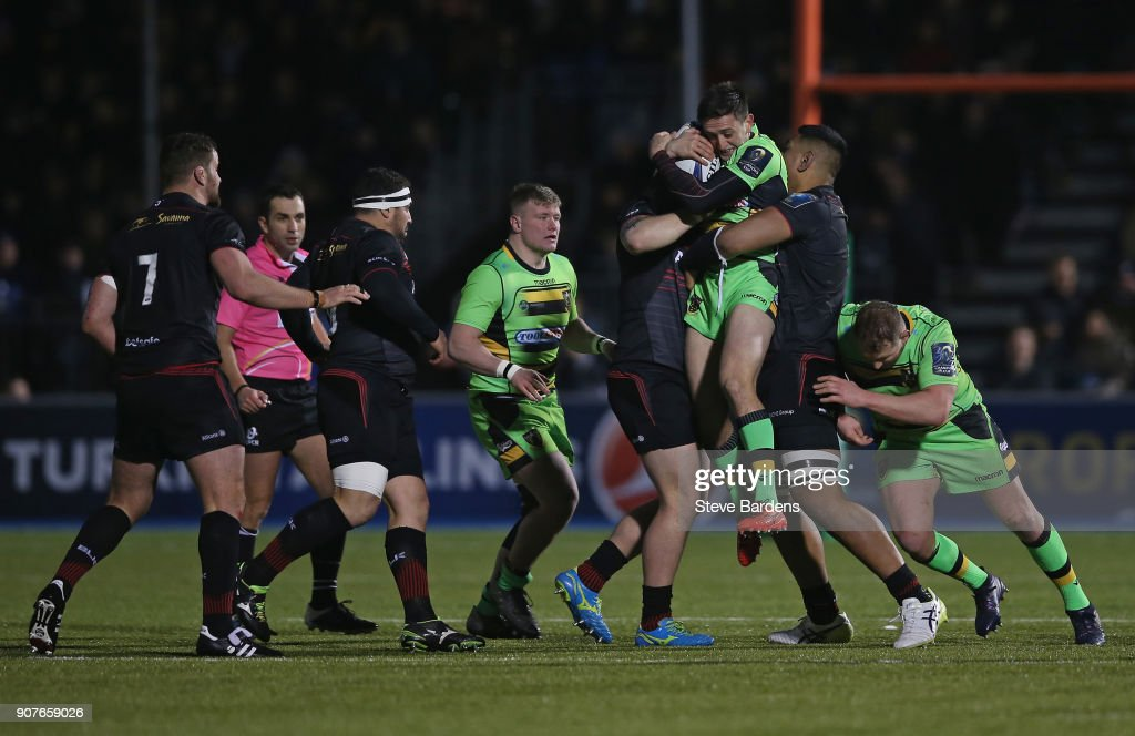 Alex Mitchell of Northampton Saints is held off the ground by the tackles of Hayden Thompson-Stringer and Will Skelton of Saracens during the European Rugby Champions Cup match between Saracens and Northampton Saints at Allianz Park on January 20, 2018 in Barnet, England.