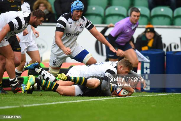 Alex Mitchell of Northampton Saints scoring a try during the Premiership Rugby Cup match between Northampton Saints and Bristol Rugby at Sixfields on...