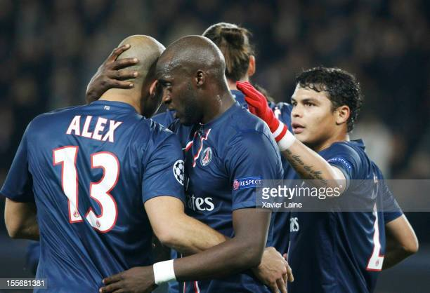 Alex Mohamed Sissoko and Thiago Silva of Paris SaintGermain celebrate a goal of Alex during the UEFA Champions League between Paris Saint Germain and...