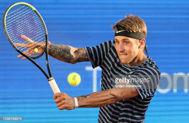 Alex Molcan of Slovakia returns a ball during his men's singles Semi Final match against Federico Delbonis of Argentina on Day 6 of the ATP 250...