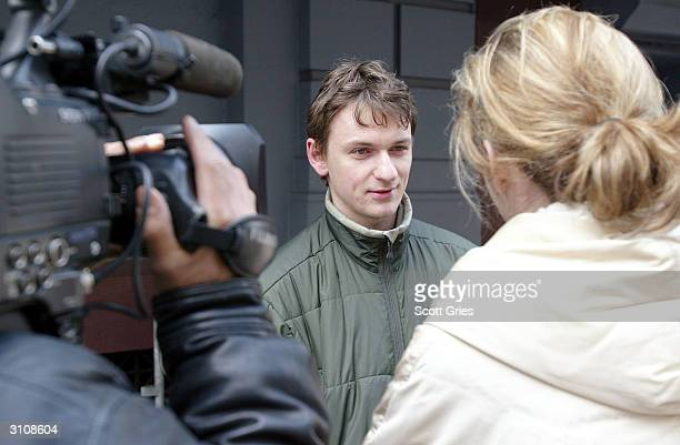 Alex Molcini who claims to be a friend of Courtney Love talks to a news crew outside of nightclub Plaid on March 18 2004 in New York City Plaid is...
