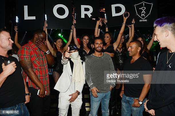 Alex Monopoly and Scott Disick attend 1OAK Nightclub at the Mirage Hotel and Casino on April 1 2016 in Las Vegas Nevada