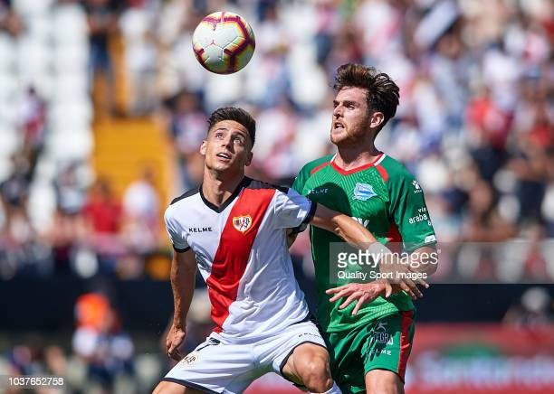 Alex Moreno of Rayo Vallecano competes for the ball with Ibai Gomez of Deportivo Alaves during the La Liga match between Rayo Vallecano de Madrid and...