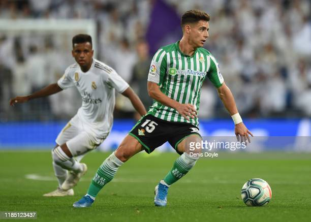 Alex Moreno of Real Betis Balompie turns to avoid Rodrygo of Real Madrid CF during the Liga match between Real Madrid CF and Real Betis Balompie at...