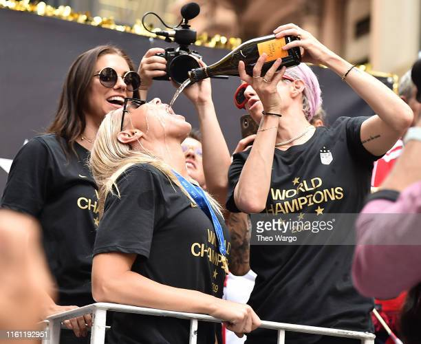 Alex Morgan Ali Krieger and Megan Rapinoe celebrate during a Victory Ticker Tape Parade for the US Women's National Soccer Team down the Canyon of...