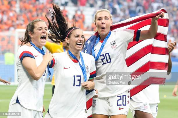 Alex Morgan and Allie Long and Samantha Mewis of USA celebrate after winning the 2019 FIFA Women's World Cup France Final match between The United...