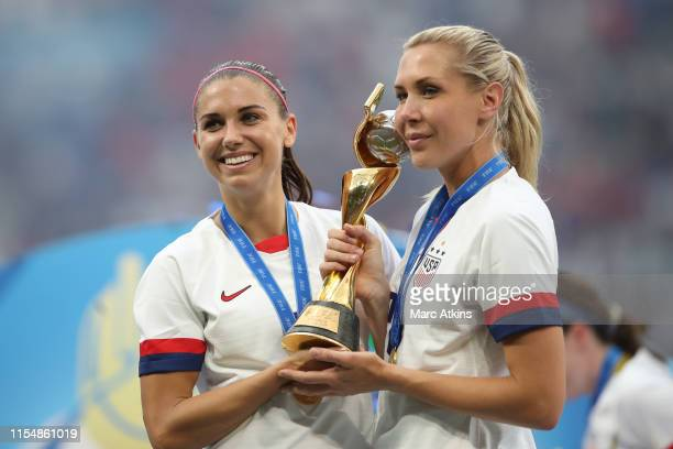 Alex Morgan and Allie Long of USA pose with the trophy during the 2019 FIFA Women's World Cup France Final match between The United States of America...