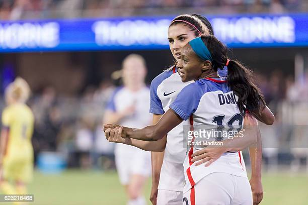 Alex Morgan and Crystal Dunn of the USA celebrate a goal during a soccer game against Romania on November 10 2016 at Avaya Stadium in San Jose...