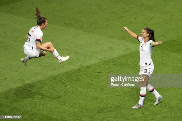 Alex Morgan and Kelley O'hara of the USA celebrate following victory in the 2019 FIFA Women's World Cup France Quarter Final match between France and...