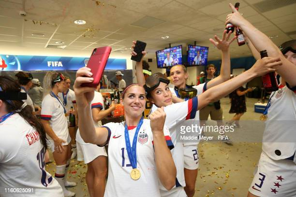 Alex Morgan and Mallory Pugh of the USA celebrate in the dressing room following the 2019 FIFA Women's World Cup France Final match between The...