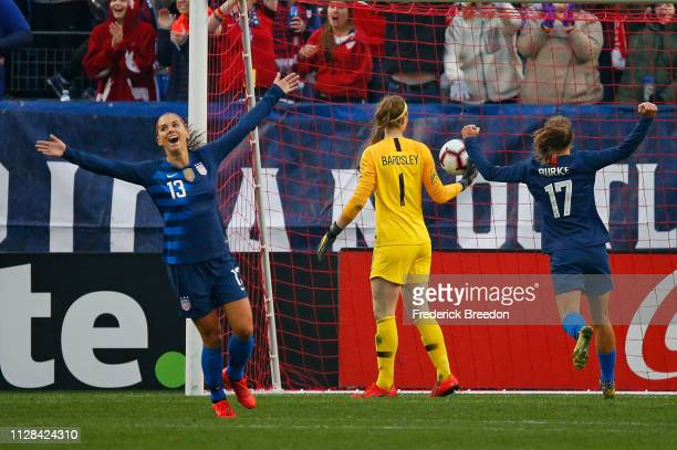 Alex Morgan and Tobin Heath of the USA celebrate after a goal against Englad during the first half of the 2019 SheBelieves Cup match between USA and...