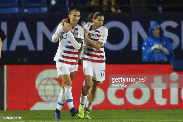 Alex morgan and Tobin Heath of United States celebrates scoring during a match between Canada and United States as part of CONCACAF Women's...