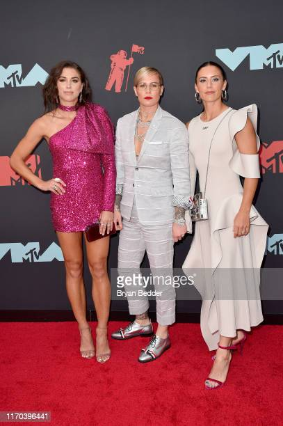Alex Morgan Ashlyn Harris and Ali Krieger attend the 2019 MTV Video Music Awards at Prudential Center on August 26 2019 in Newark New Jersey