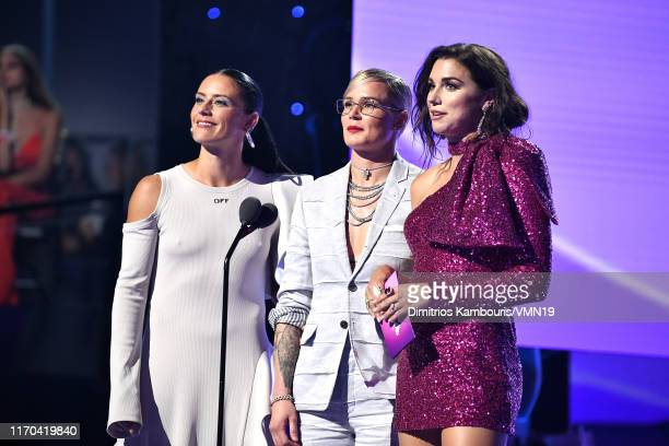 Alex Morgan Ashlyn Harris and Ali Krieger speak onstage during the 2019 MTV Video Music Awards at Prudential Center on August 26 2019 in Newark New...
