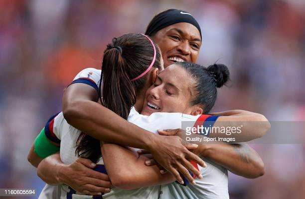 Alex Morgan Jessica McDonald and Ali Krieger of USA celebrate at full time of the 2019 FIFA Women's World Cup France Final match between The United...