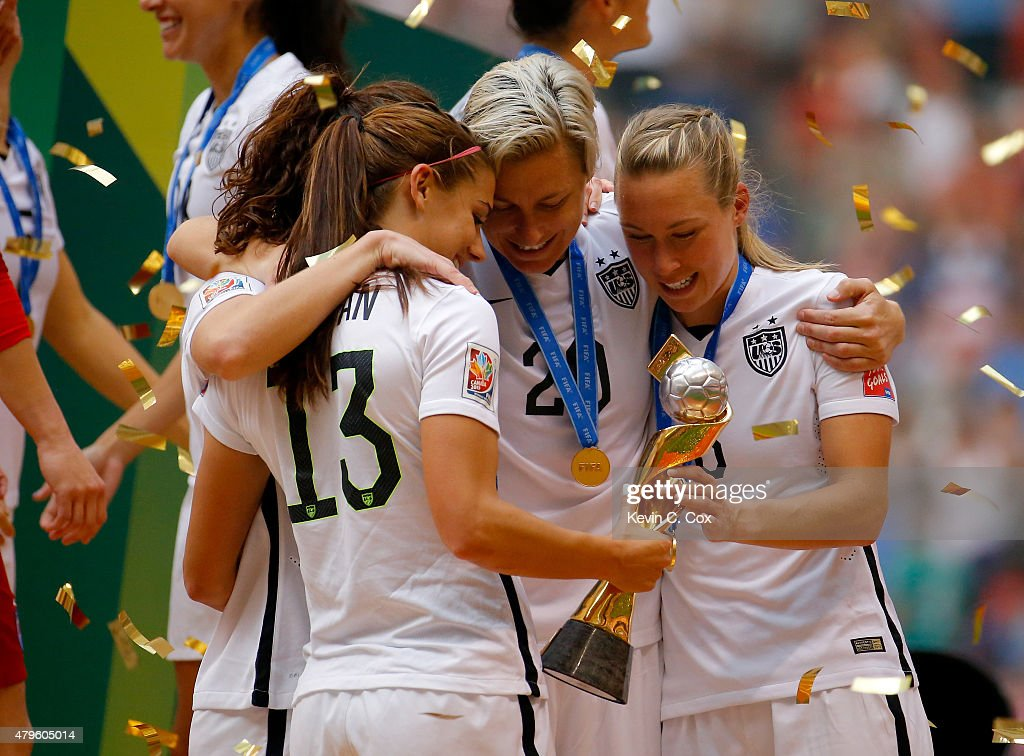 Alex Morgan #13, Lauren Holiday #12, Abby Wambach #20 and Whitney Engen #6 of the United States of America hold the World Cup Trophy after their 5-2 win over Japan in the FIFA Women's World Cup Canada 2015 Final at BC Place Stadium on July 5, 2015 in Vancouver, Canada.