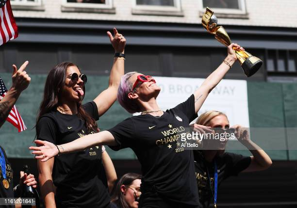 Alex Morgan Megan Rapinoe and Allie Long celebrate during the US Women's National Soccer Team Victory Parade and City Hall Ceremony on July 10 2019...