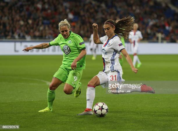 Alex Morgan of Olympique Lyon battles with Anna Blasse of VFL Wolfsberg during the Women's Champions League match between Lyon and Wolfsburg at Stade...