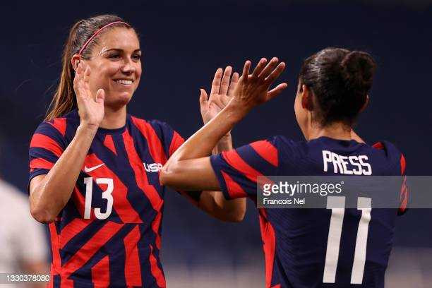 Alex Morgan of Team United States celebrates their side's sixth goal, an own goal by Catherine Bott of Team New Zealand with team mate Christen Press...