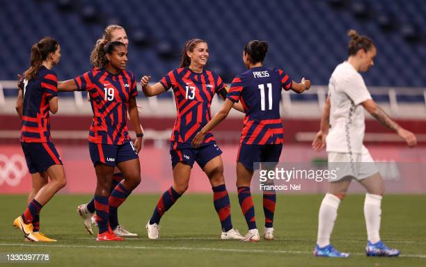 Alex Morgan of Team United States celebrates with Catarina Macario and Christen Press after scoring their side's fifth goal during the Women's First...