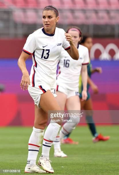 Alex Morgan of Team United States looks on while playing against Australia during the Women's Group G match on day four of the Tokyo 2020 Olympic...
