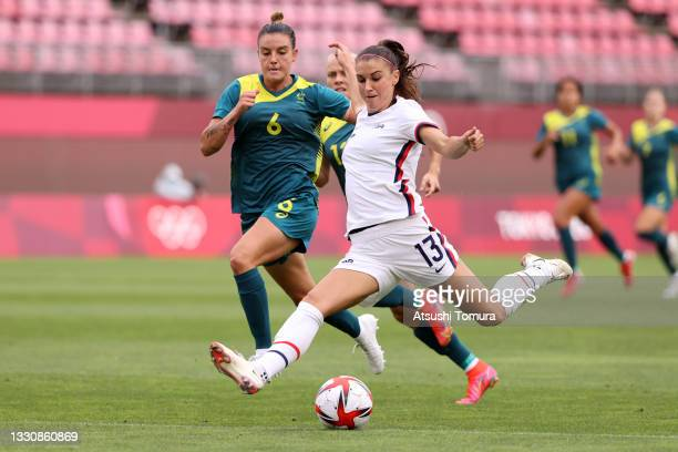 Alex Morgan of Team United States shoots whilst under pressure from Chloe Logarzo of Team Australia during the Women's Football Group G match between...