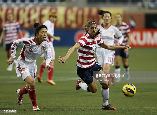 Alex Morgan of Team USA dribbles the ball against Dongni Wang of China during the game at Ford Field on December 8 2012 in Detroit Michigan USA...