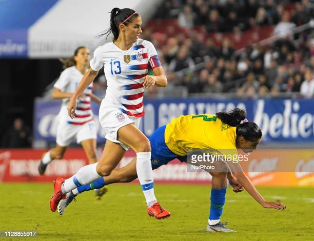 Alex Morgan of The United States against Andressa of Brazil during the SheBelieves Cup match between The United States and Brazil at Raymond James...