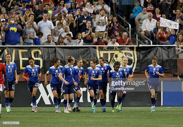 Alex Morgan of the United States along with teammates Christen Press Carli Lloyd Becky Sauerbrunn Morgan Brian Meghan Klingenberg Tobin Heath Crystal...