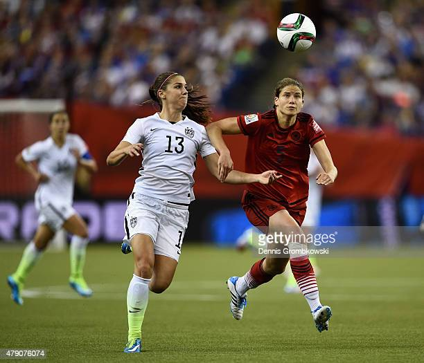 Alex Morgan of the United States and Annike Krahn of Germany battle for the ball in the FIFA Women's World Cup 2015 SemiFinal Match at Olympic...
