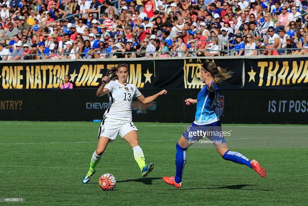 Alex Morgan #13 of the United States attempts a shot against Erika #14 of Brazil during a Women's International Friendly soccer match at Orlando Citrus Bowl on October 25, 2015 in Orlando, Florida.