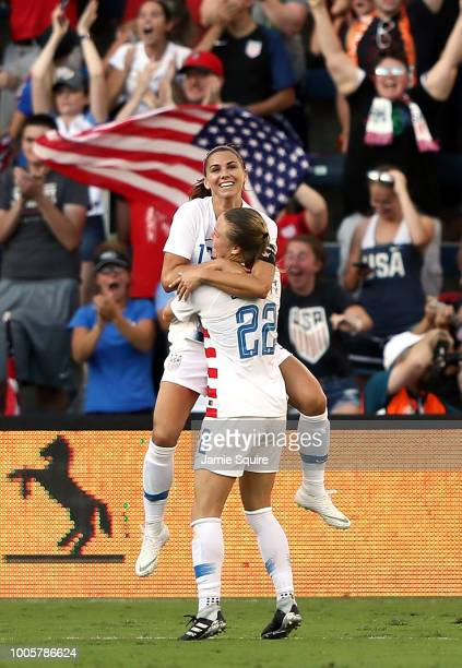 Alex Morgan of the United States celebrates with Emily Sonnett after scoring during their Tournament Of Nations match against Japan at Children's...