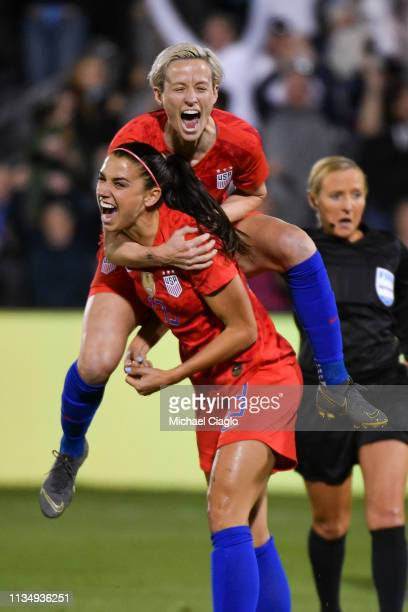 Alex Morgan of the United States celebrates with Megan Rapinoe after scoring her 100th international goal against Australia at Dick's Sporting Goods...