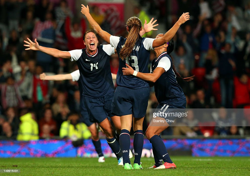 Alex Morgan #13 of the United States celebrates with Sydney Leroux #11 and Abby Wambach (L) after she scored in extra time during the Women's Football Semi Final match between Canada and USA, on Day 10 of the London 2012 Olympic Games at Old Trafford on August 6, 2012 in Manchester, England.