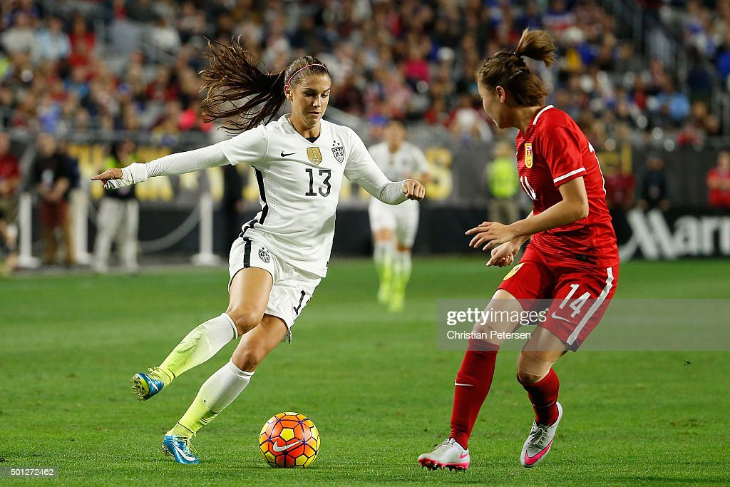 Alex Morgan #13 of the United States controls the ball against Zhao Rong #14 of China during the second half of the women's soccer match at University of Phoenix Stadium on December 13, 2015 in Glendale, Arizona. USA defeated China 2-0.