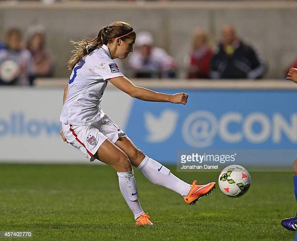 Alex Morgan of the United States fires a shot against Guatemala during the 2014 CONCACAF Women's Championship at Toyota Park on October 17 2014 in...