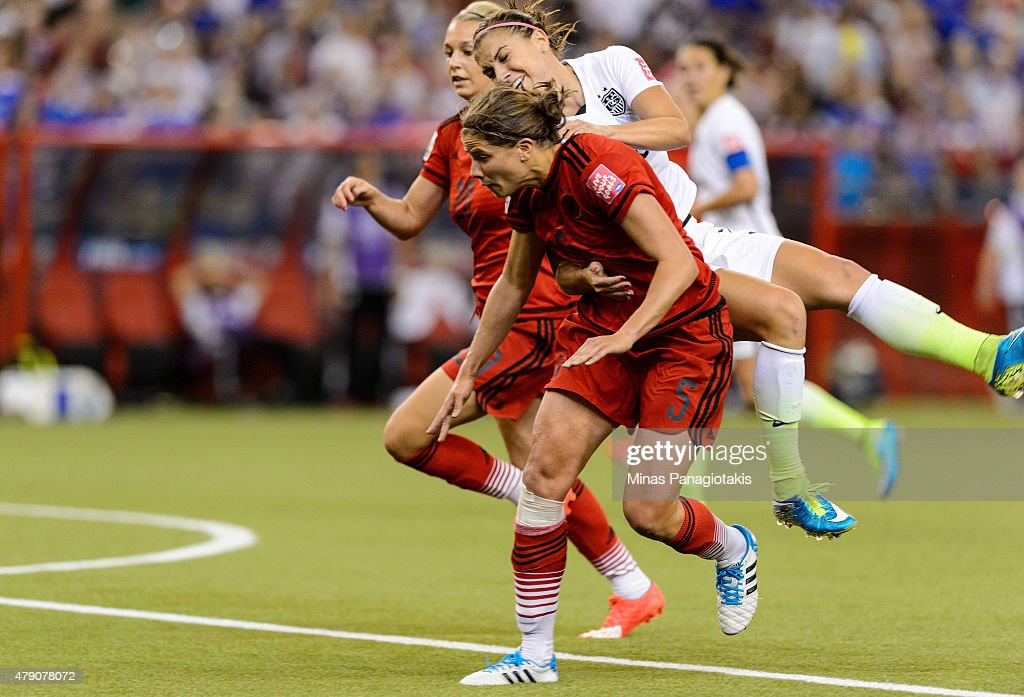 Alex Morgan #13 of the United States is fouled in the box by Annike Krahn #5 of Germany in the second half as Krahn is called for a penalty in the FIFA Women's World Cup 2015 Semi-Final Match at Olympic Stadium on June 30, 2015 in Montreal, Canada.