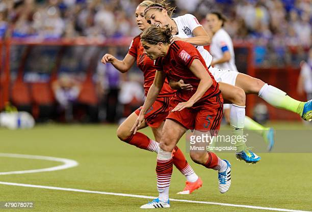 Alex Morgan of the United States is fouled in the box by Annike Krahn of Germany in the second half as Krahn is called for a penalty in the FIFA...
